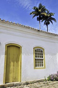 Palm trees behind facade in the historic city of Paraty, Parati, Rio de Janeiro, South America