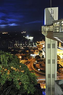 View of the lower city Cidade Baixa and lift Elevador Lacerda at night, Salvador, Bahia, UNESCO World Heritage Site, Brazil, South America