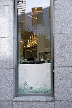 Break-in, broken display window of a jeweller's shop