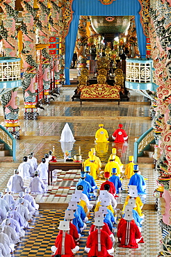 "Monks and nuns praying, holy altar ""the eye"", ceremonial midday prayer in the Cao Dai temple, Tay Ninh, Vietnam, Asia"