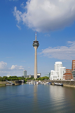 "Duesseldorf Harbour, Rheinturm Tower and Neuer Zollhof, ""Tanzende Buerobauten"" by F. O. Gehry, pleasure crafts at jetty, Dusseldorf, North Rhine-Westphalia, Germany, Europe"