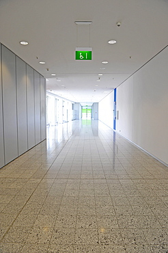 Escape corridor with a sign for wheelchair users
