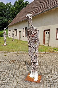 Bronze statues of former inmates in the former waterworks of the women's concentration camp Ravensbrueck, Brandenburg, Germany, Europe
