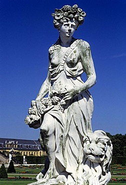 Allegorical statue, woman with fruits and flowers in her hair, lion, Herrenhaeuser Gardens, Hanover, Lower Saxony, Germany, Europe