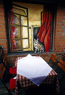 Katzencafe, cat cafe, table at wall with painted on window and cat, historical Schnoorviertel district, Schnoor, Bremen, Germany, Europe