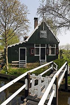 Traditional Dutch wooden house with footbridge, open-air museum Zaanse Schans, Zaandam, North Holland, Netherlands, Europe