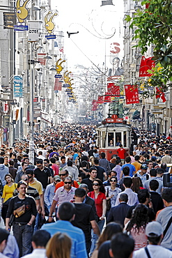 Historic tram driving through the crowd, shopping street Istiklal Caddesi, Independence Street, Beyoglu, Istanbul, Turkey