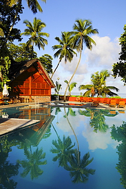 Coconut palms reflected in the pool, Berjaya Beau Vallon Bay Hotel, Mahe Island, Seychelles, Africa, Indian Ocean