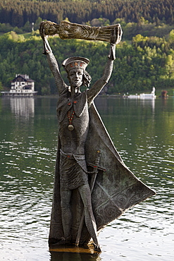 Statue of St. Domitian, created in 1994 by Prof. Giorgio Igne, Millstaetter See, Millstatt Lake, Millstatt, Carinthia, Austria, Europe