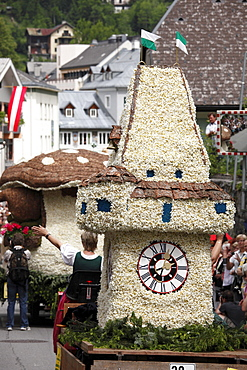 Graz clock tower, car parade with characters from daffodils, Narzissenfest Narcissus Festival in Bad Aussee, Ausseer Land, Salzkammergut area, Styria, Austria, Europe