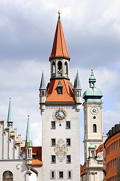 The old town hall tower with the bell tower of the Heilig-Geist-Kirche Holy Spirit Church on the Marienplatz square in Munich, Bavaria, Germany, Europe