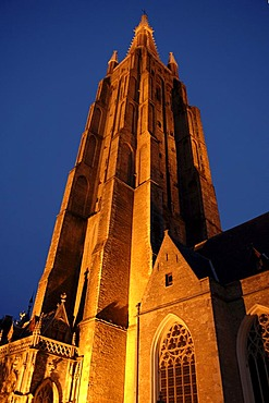 Illuminated tower of the Church of Our Lady, Bruges, Belgium, Europe