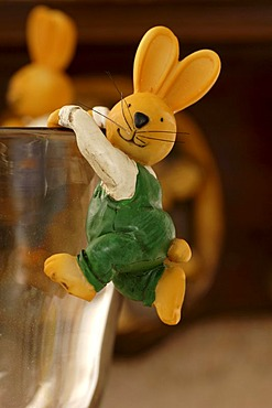 Easter decoration, Easter bunny figurine climbing a drinking glass, Villa Ambiente, Nuremberg, Middle Franconia, Bavaria, Germany, Europe