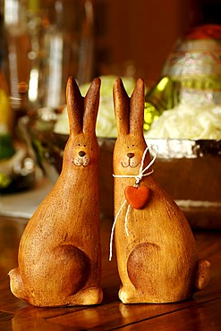 Easter decoration, two clay Easter bunnies on an Easter table