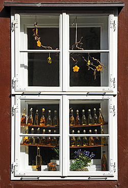 Old window of a shop decorated with olive oil bottles, Lueneburg, Lower Saxony, Germany, Europe