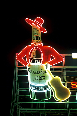 Tio Pepe, neon sign on the central square of Plaza Puerta del Sol at Night, Madrid, Spain, Europe
