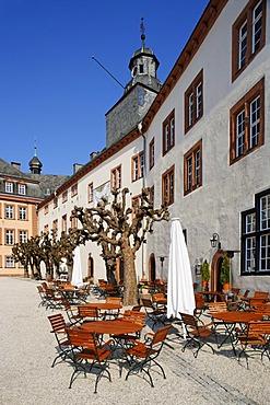 """North wing with restaurant """"Schloss-Schaenke"""", patio, Berleburg Castle, Bad Berleburg, district of Siegen-Wittgenstein, Rothaarsteig, North Rhine-Westphalia, Germany, Europe"""