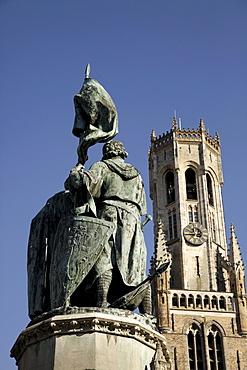 Statue of the Bruges folk heroes Jan Breydel and Pieter de Coninck, on the market square Grote Markt, in the historic centre of Bruges, Belgium, Europe