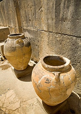 Large ancient pithoi, similar to amphoras, at the excavation site of the Minoan palaces of Festos, island of Crete, Greece, Europe