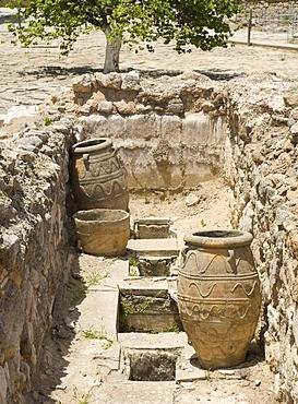 Large ancient pithoi, similar to amphoras, on the grounds of the Minoan excavation of Knossos, Heraklion, island of Crete, Greece, Europe