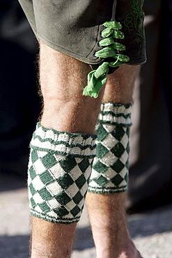 Man wearing so called Wadelwaermer, diamond-patterned woolen accessoire for keeping the calves warm, Bavarian costume, in Seehausen, Bavaria, Germany, Europe