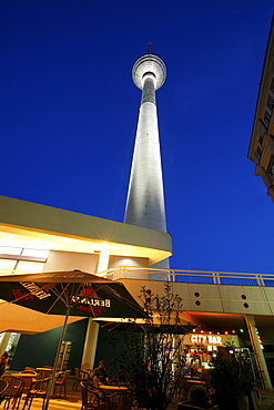 Forecourt of the Fernsehturm TV tower and Bahnhof Alexanderplatz station at the blue hour, Mitte district, Berlin, Germany, Europe