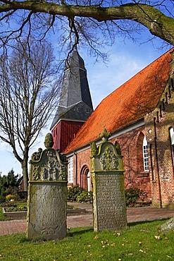 Old gravestones in front of the St. Nicolai-Kirche church in Beidenfleth, district Steinburg, Schleswig-Holstein, Germany,