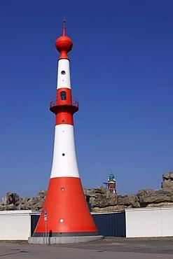 "Old lighthouses in Bremerhaven, red-wight Bremerhavener Leuchtbarke Unterfeuer ""Minarett"" lighthouse in the front, Grosser Leuchtturm Bremerhavener Oberfeuer ""Loschenturm"" lighthouse in the back, between them a zoo on the sea, Bremerhaven, hanaseatic city"