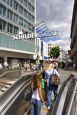 Schildergasse at Neumarkt, shopping street, passers-by, shopping, shops, escalator, Cologne, North Rhine-Westphalia, Germany, Europe
