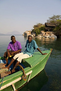 Staff on a boat, Mumbo Island Camp, Cape Maclear Peninsula, Lake Malawi, Malawi, South East Africa