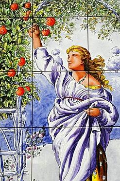Spanish tiles, azulejos, romantic representation of a woman plucking an apple, Madrid, Spain, Europe