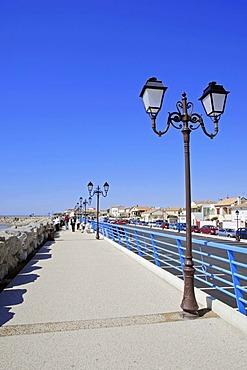 Seafront promenade with lanterns, Les Saintes-Maries-de-la-Mer, Camargue, Bouches-du-Rhone, Provence-Alpes-Cote d'Azur, Southern France, France, Europe