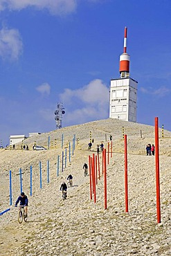 Mountainbikers and tower of the weather station on the peak of Mont Ventoux, Vaucluse, Provence-Alpes-Cote d'Azur, Southern France, Europe