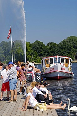 People on the Alster Lake steamer quay in Hamburg, Germany, Europe