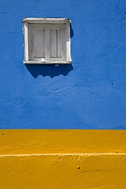 Wall painted in bright blue and yellow, wooden window, Santo Domingo, Venezuela, South America