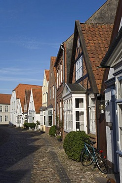 Cobbled street and houses with bay windows in the historic centre of Tondern, Jutland, Denmark, Northern Europe