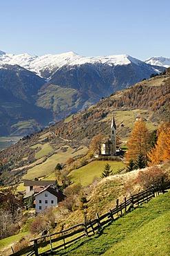 View from Tannas with the Sacred Heart Church across the Etsch valley to the mountains around Stelvio Pass, Passo dello Stelvio, Vinschgau, Val Venosta, Alto Adige, Italy, Europe