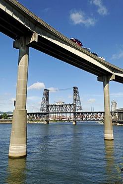 Motorway bridge and historic Steel Bridge, Willamette River, Portland, Oregon, USA