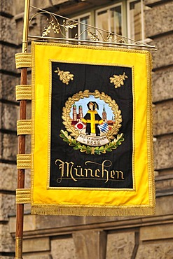 Munich's coat of arms displayed on a flag during the Oktoberfest's traditional costume procession, Munich, Bavaria, Germany, Europe