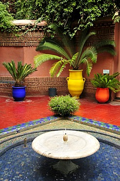 Water basin and flower pots in the Jardin Majorelle, Marrakech, Morocco, Africa