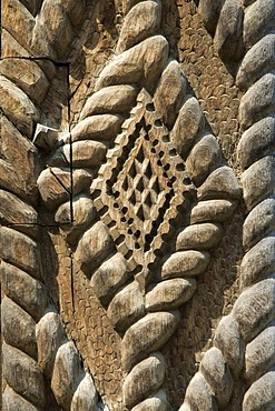 Carved wooden portal symbolizing infinity, Maramures, Romania