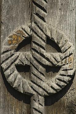Carved wooden portal, disc symbolizing the sun, Maramures, Romania