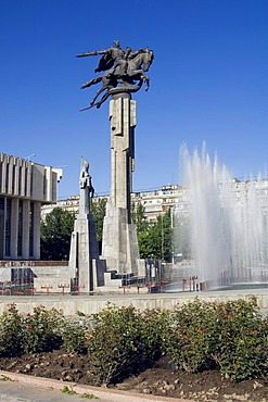 The Philharmonic house, in the foreground statues evocating the epic poem Manas, Bishkek, Kyrgystan