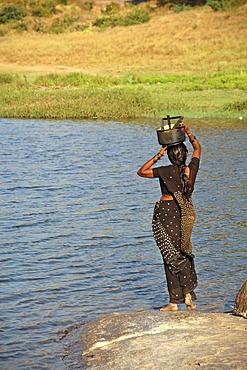 Indian woman fetching water, Hampi, Karnataka, India, South Asia