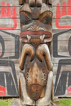 Totem pole outside a Native American long house, detail, K'san Historical Village Museum, Hazelton, British Columbia, Canada, North America