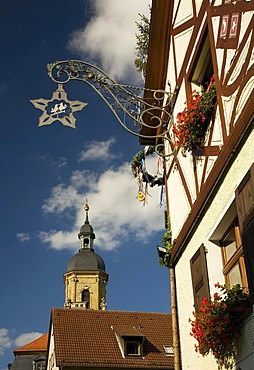 Guild sign on a hotel and the Basilica in Goessweinstein, Franconian Switzerland, Upper Franconia, Bavaria, Germany, Europe