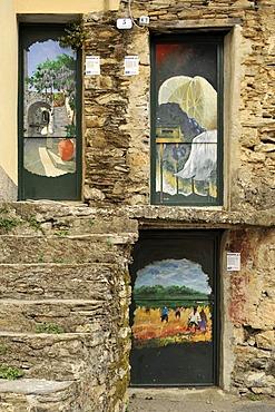The gates of Valloria, art on doors, open-air museum, district of Dolcedo, Riviera dei Fiori, Liguria, Italy, Europe