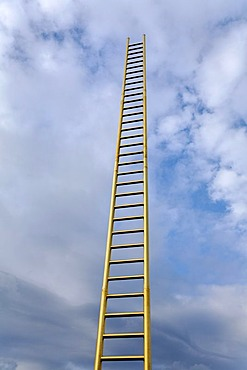Golden ladder soaring into the clouded sky, Duisburg, North Rhine-Westphalia, Germany, Europe