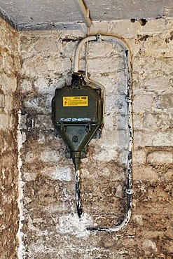 House connection, current 330 V with fuse panel 63 A in a house cellar before renovation, damp walls, Germany, Europe