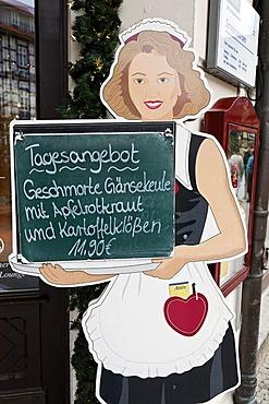 Cardboard waitress displaying the menu of the day, braised leg of goose, Wernigerode, Harz, Saxony-Anhalt, Germany, Europe
